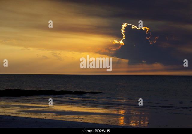 A magnificent sunset over Holbox Island, Quintana Roo, Yucatán Peninsula, Mexico, clouds with gold lining gold - Stock Image
