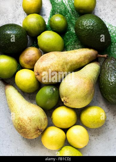 Overhead view of yellow and green colour fruits - Stock Image