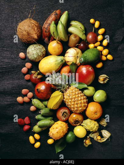 Different sort of exotic fruits black background - Stock Image
