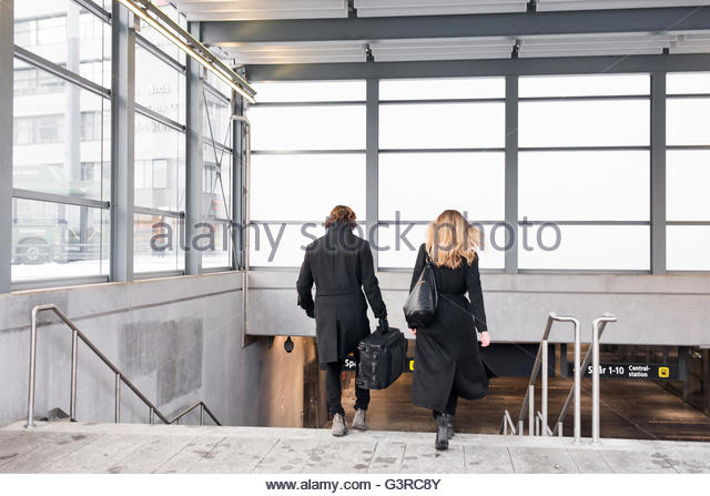 Sweden, Skane, Malmo, Rear view of couple entering subway station - Stock Image