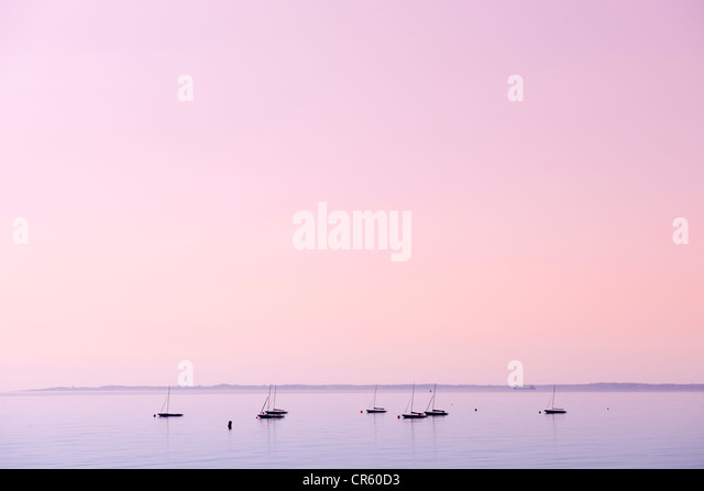 Boats on water at Whitehead on the County Antrim coast northern ireland - Stock Image