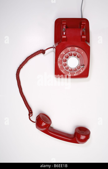 Overhead view of red telephone - Stock Image