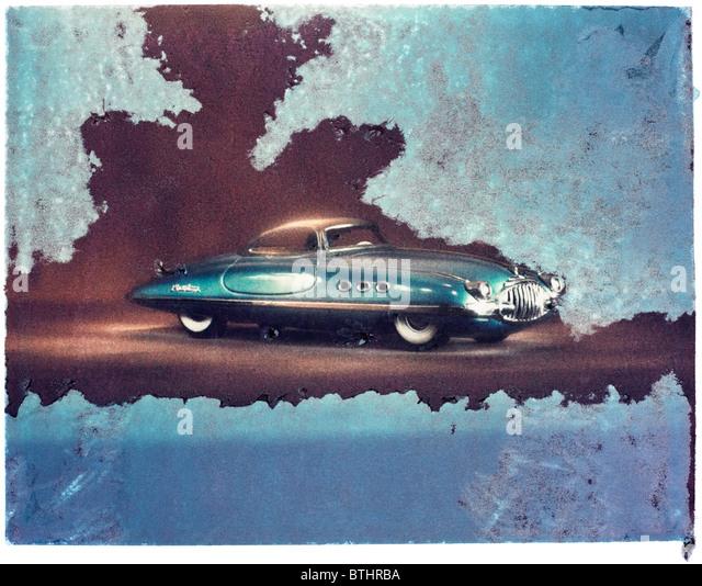 Polaroid transfer of futuristic tin model car. - Stock Image