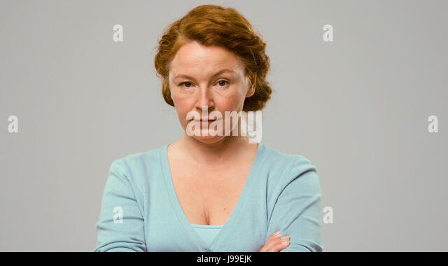 Mid-aged actress shows the emoltion of doubt - Stock Image