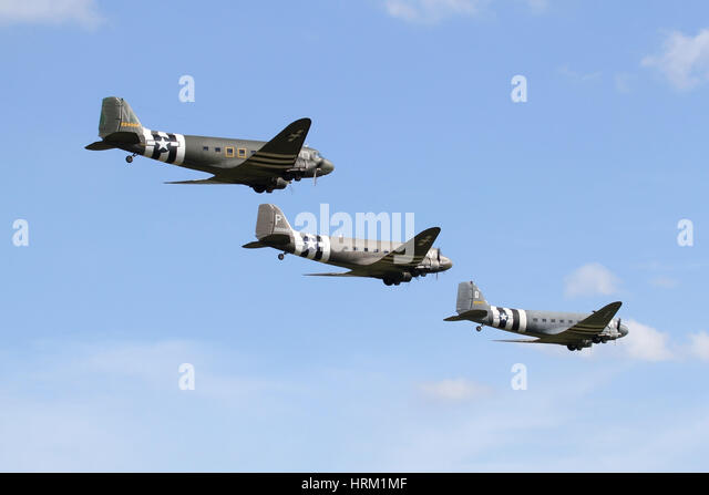 A formation of three Douglas DC-3/C-47s at the 70th anniversary of D-Day airshow hosted by Duxford in 2014. - Stock Image