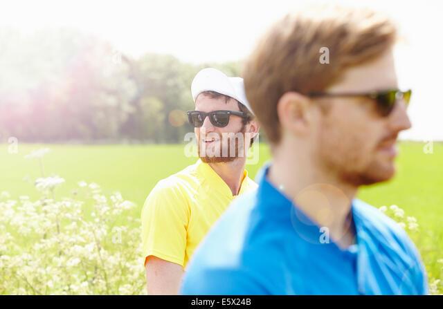 Cyclists wearing biking cap and sunglasses - Stock Image