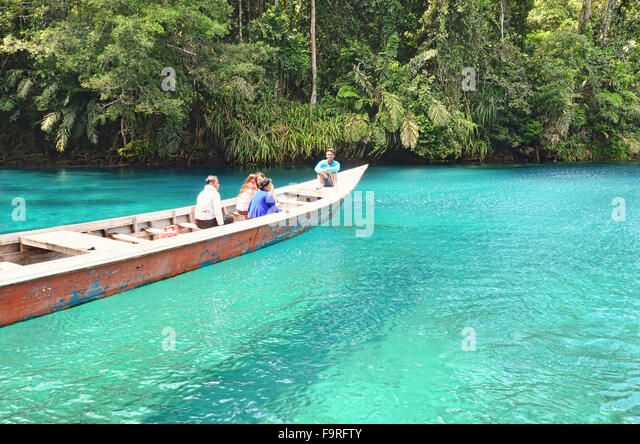 A boat looks like floating on the surface of Labuan Cermin Lake - Stock Image