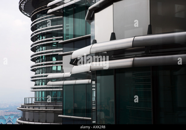 business working new city skyscraper building windowns office lines angles round ground drive down modern distance - Stock Image