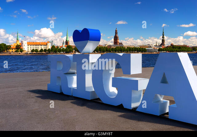 Panorama of Riga against the blue sky with clouds and with the inscription of the channel letters with heart symbol - Stock Image