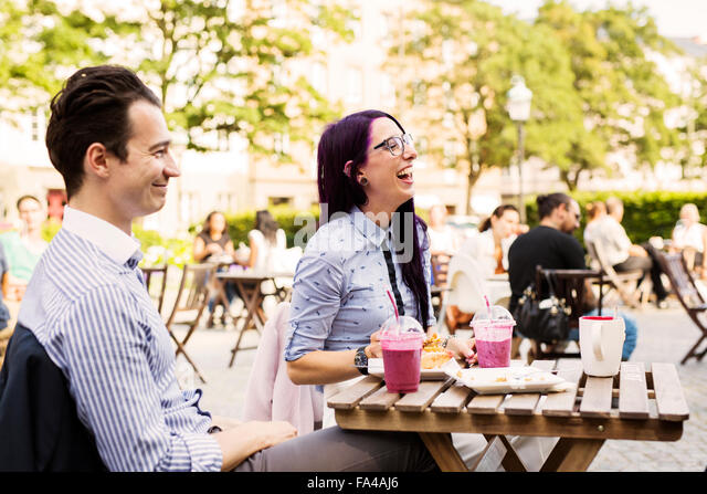 Friends having fun at outdoor cafe - Stock Image