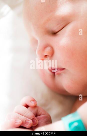 Sleeping baby girl (0-1 months) - Stock Image