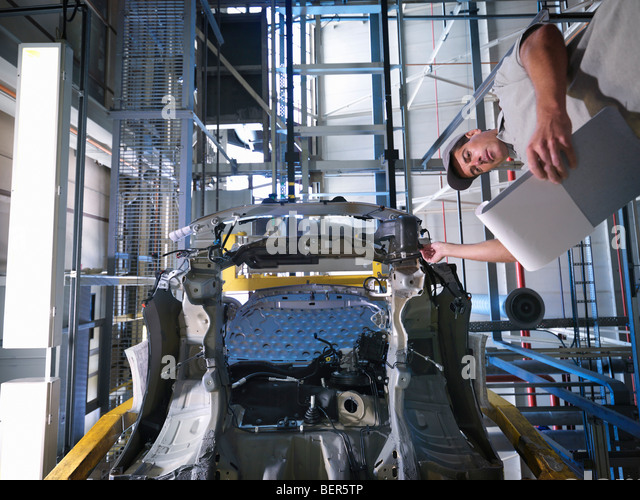 Car Plant Worker & Car From Below - Stock Image