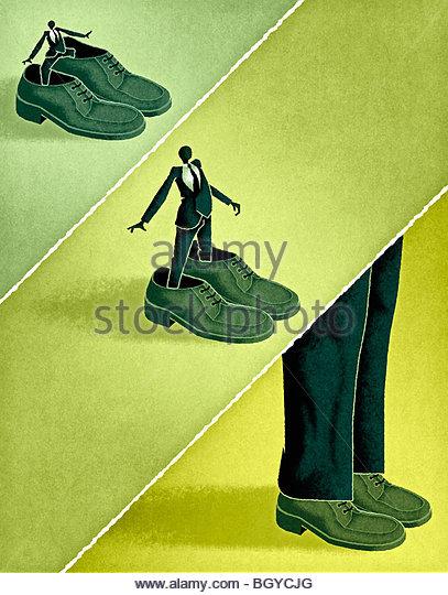 Businessmen wearing big shoes - Stock-Bilder