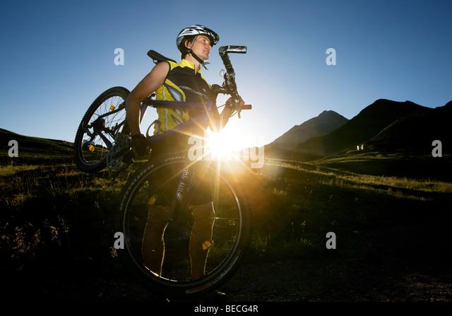 Mountainbiker carrying his bike, Northern Tyrol, Austria, Europe - Stock Image