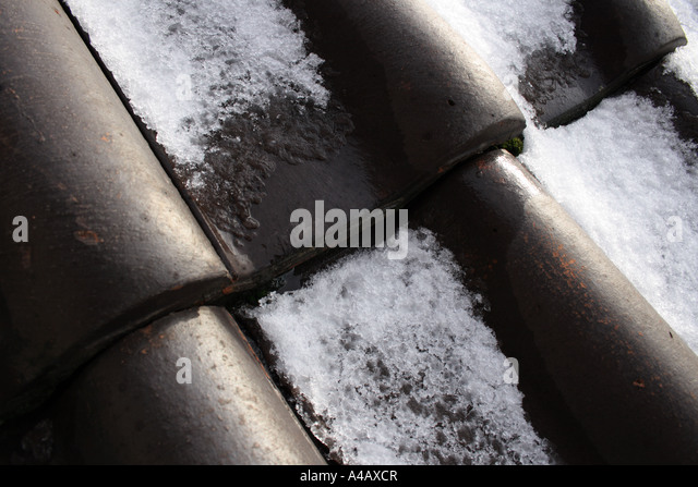 melting snow on roof of a German house. Photo by Willy Matheisl - Stock Image