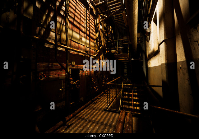 Rusty structures of an abandoned power station - Stock Image
