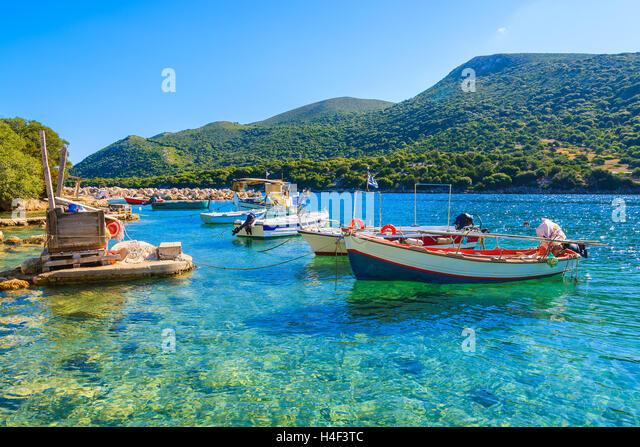 Greek fishing boats on turquoise sea water, Kefalonia island, Greece - Stock Image