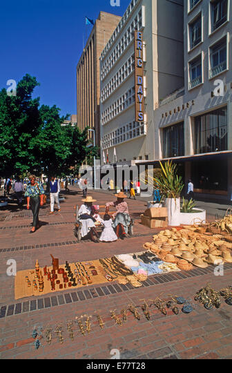 Street scene with tourist souvenirs along sidewalk in Harare City, the capital of Zimbabwe in Southeast Africa - Stock Image