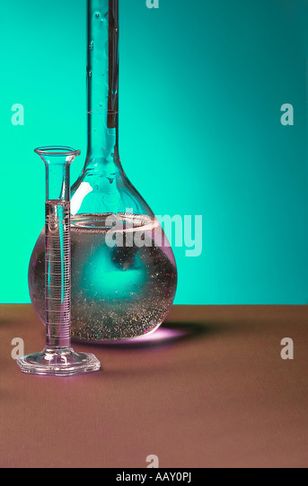 Clear Glass Beaker Vial With Bubbles In Liquid In Research And Science Development Lab Laboratory, USA - Stock Image