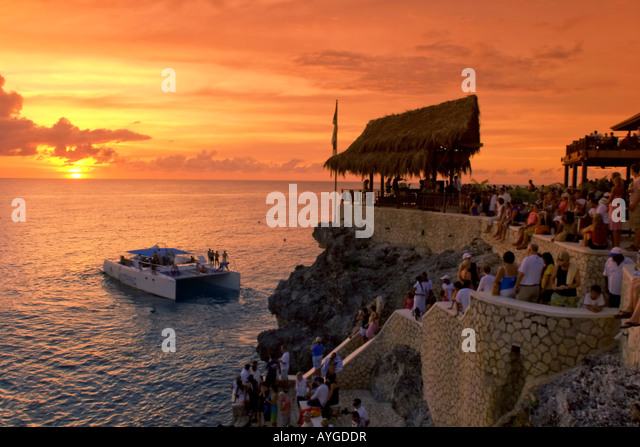 Jamaica Negril Rick s Cafe open air bar viewpoint at sunset - Stock Image