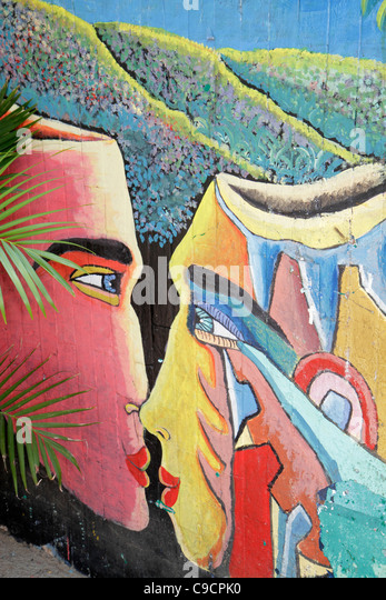 Nicaragua Managua Bolonia wall mural restaurant painting art faces kissing colorful abstract - Stock Image