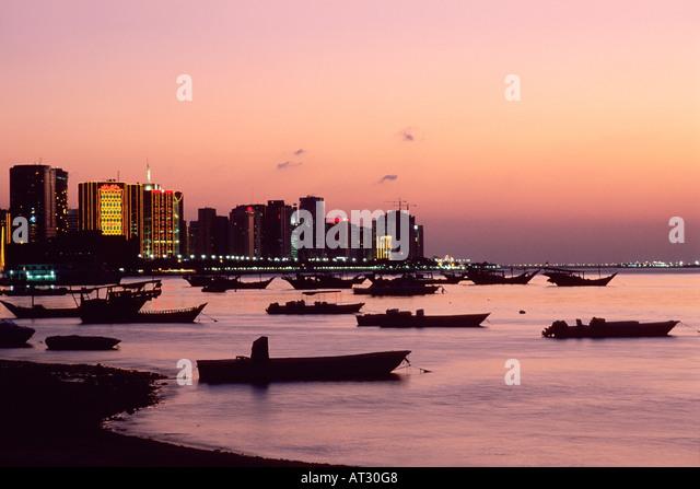 City skyline at dusk Abu Dhabi United Arab Emirates - Stock Image