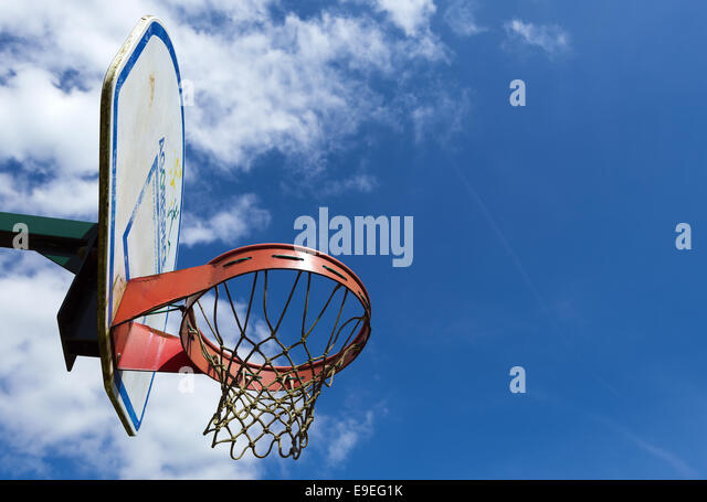 Side view of basketball backboard and hoop in children's playground - Stock Image