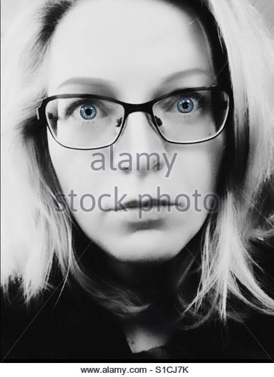 Headshot of a woman with glasses - Stock-Bilder