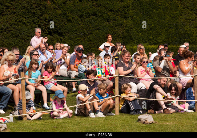 UK, England, Warwickshire, Warwick Castle, audience applauding falconry display - Stock Image