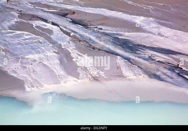 Pollution from industrial run off from a nearby granite cutting factory - Stock Image