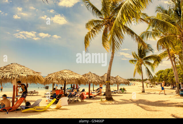 Trinidad Cuba beautiful white sandy beach near the Club Amigo Ancon with blue water and waves - Stock Image