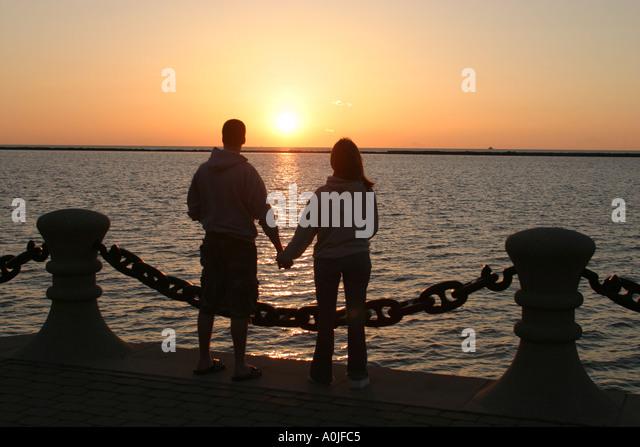 Cleveland Ohio Lake Erie Voinovich Park couple sunset - Stock Image