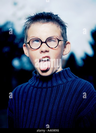 A young boy putting on a goofy face - Stock Image