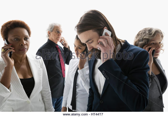 Business people talking on cell phones against white background - Stock-Bilder