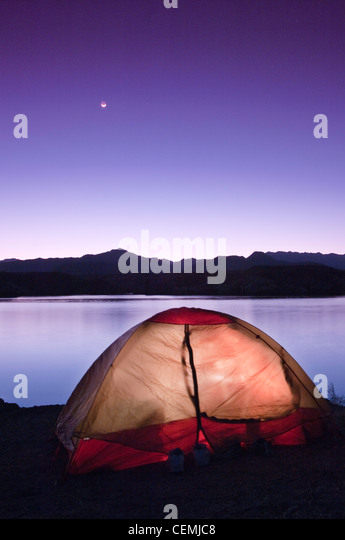 Camping by the Colorado River while the moon sets, Arizona Bay, Arizona - Stock-Bilder