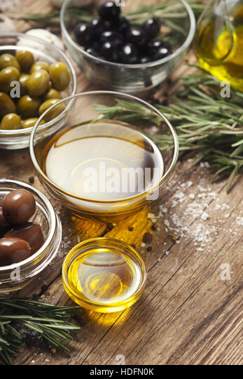 Olive oil  with olives mix  on the wooden table  vertical - Stock Image