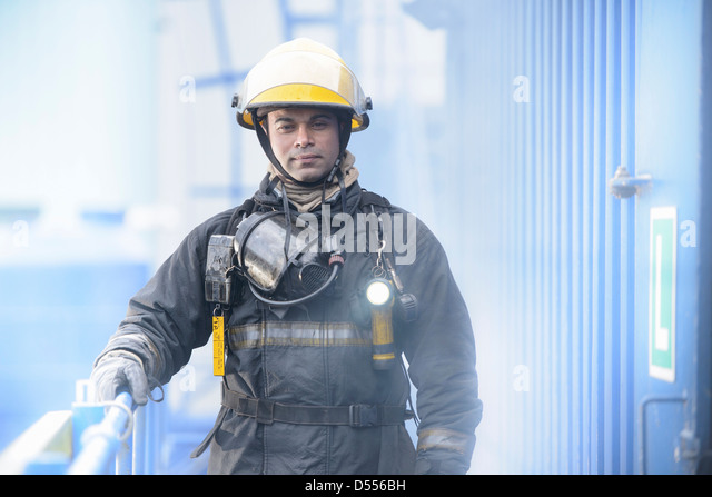 Firefighter standing on platform - Stock Image