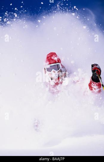 Man skiing deep powder in Utah. - Stock Image
