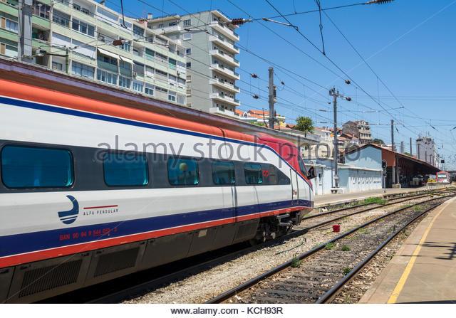 Lisbon Portugal Santa Apolonia Comboios de Portugal railway train track Alfa Pendular Pendolino high-speed tilting - Stock Image