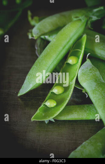 Young green peas - Stock Image