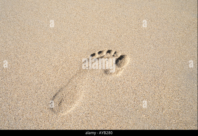 Footprint in the sand - Stock Image