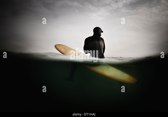 Surfer on Surfboard Anticipating Wave - Stock Image