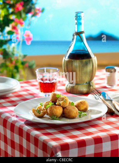 Rice and pea Croquettes on a terrace in Sicily - Stock Image