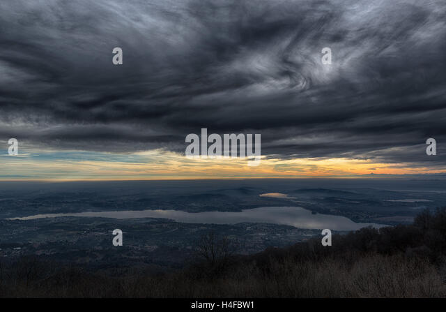 Dramatic sky at the sunset over the Varese lake, rainy season - Lombardy, italy - Stock Image