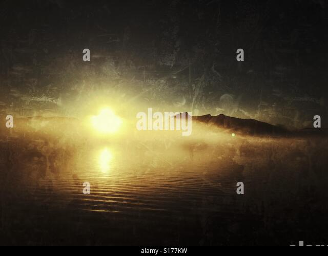 Sun and fog over byfjorden, Bergen, Norway - Stock Image