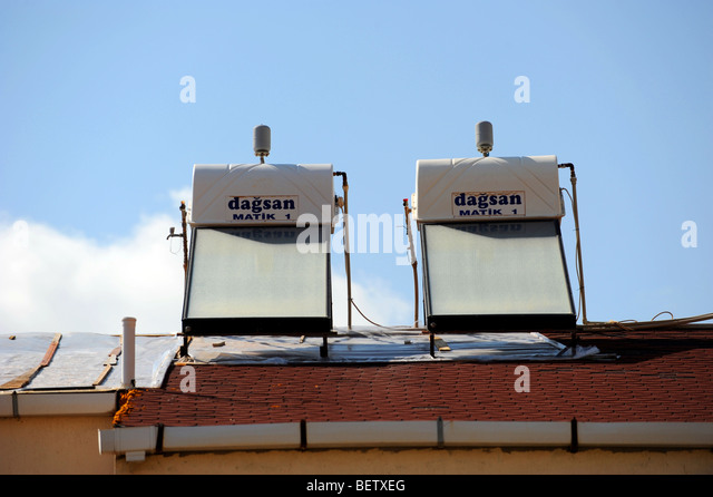 Two solar powered water heaters on the roof of a villa in Kalkan - Stock Image