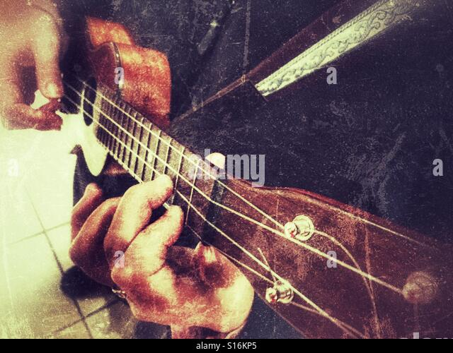 Woman playing a soprano ukulele - Stock-Bilder