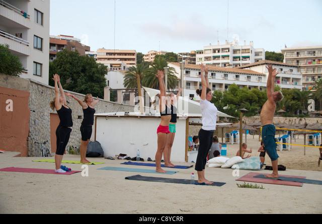 stretching gymnastics exercise class in the beach Mallorca Majorca Balearic  Spain - Stock Image