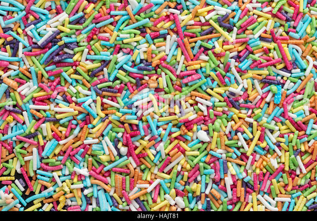 Colorful candy sprinkles background - Stock Image