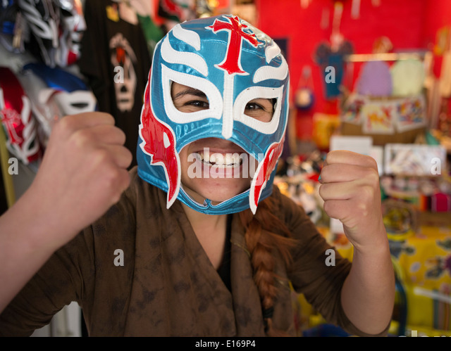 Mexican wrestling masks on sale at Tope a Mexican goods store in Kosetsu Ichiba Market, off Kokusai Street, Naha - Stock Image